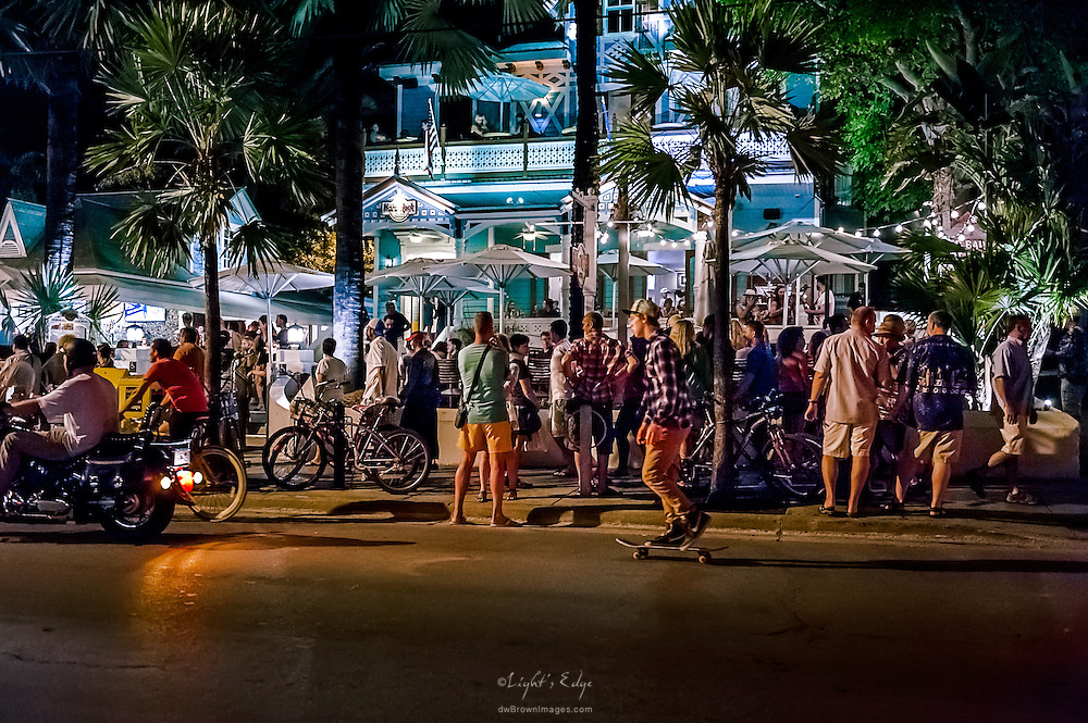 A night view of people and the Hard Rock Cafe on Duval Street in Key West, Florida.
