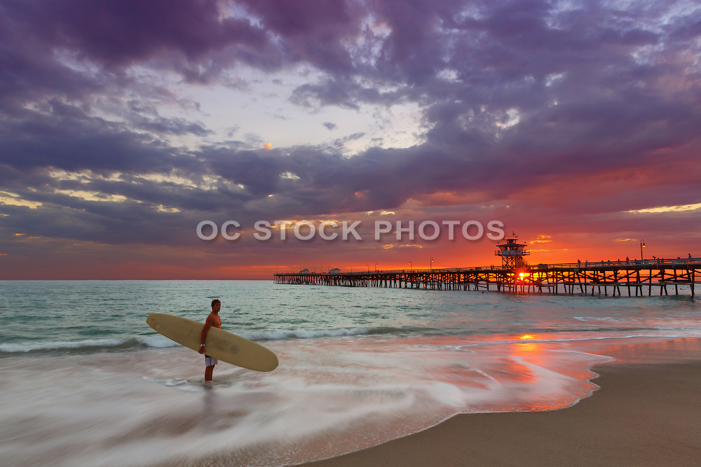 Longboard Surfer Standing in the Water at Dusk in San Clemente