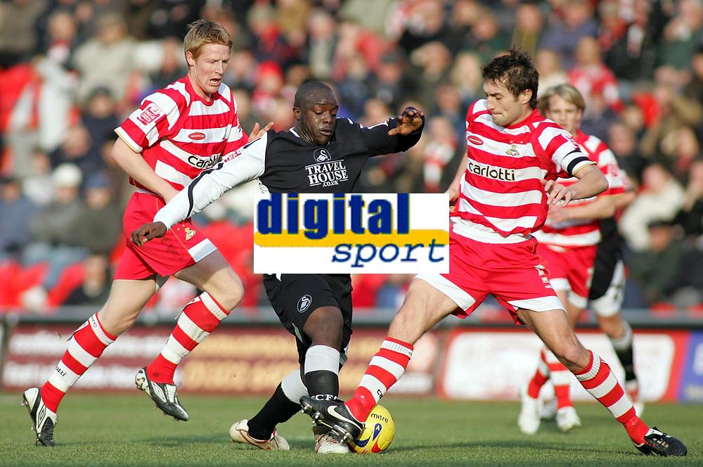 Photo: Paul Thomas.<br /> Doncaster Rovers v Swansea City. Coca Cola League 1. 17/02/2007.<br /> <br /> Adebayo Akinfenwa (C) of Swansea tries to beat Graeme Lee (R) and Adam Lockwood (L).