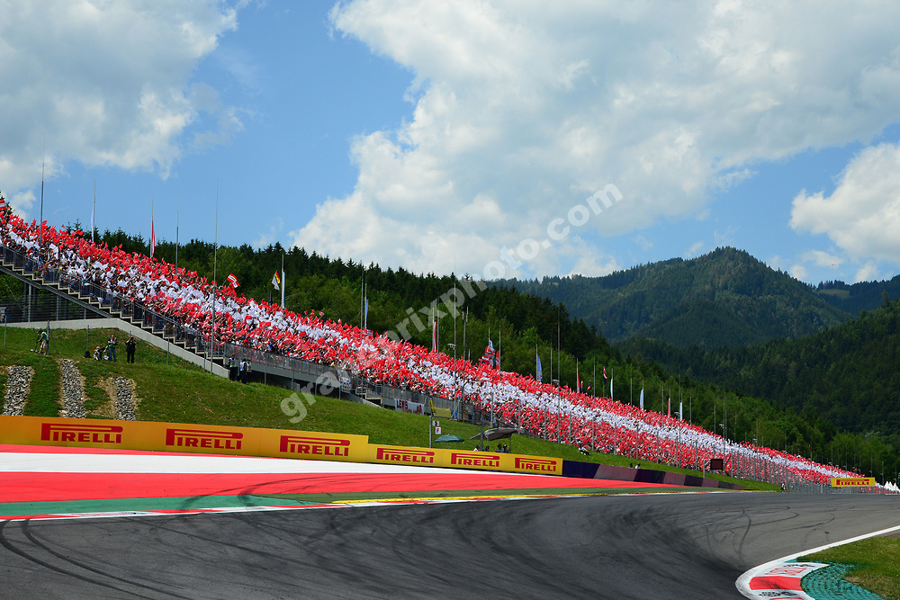 Fans on grandstand make Austrian flag before the 2014 Austrian Grand Prix at the Red Bull Ring in Spielberg. Photo: Grand Prix Photo