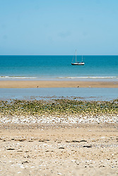 Bridlington North Beach with a small Yacht sitting out in the bay<br />