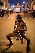 """In Carnival parades in Mindelo, attempts to recover the tradition of """"mandigas"""" groups are made. These were members of African groups also used as slaves in Cape Verde. They rumble the streets chaotically playing with the audience. They are generally from the poorer strata of population."""