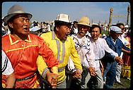 Sakha men join in osuokhai -ritual circle dance and chant- at the midsummer Ysyakh fest; Yakutsk. Russia