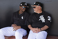 GLENDALE, ARIZONA - MARCH 04:  Eloy Jimenez #74 (L) talks with Manager Rick Renteria #36 of the Chicago White Sox prior to the game against the Los Angeles Angels on March 4, 2019 at Camelback Ranch in Glendale Arizona.  (Photo by Ron Vesely)  Subject:  Eloy Jimenez; Ricky Renteria