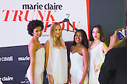 (l-r) Megan Masella, Dayna Hegarty, Anathi Dlamini and Kaylin Shapiro have their photo taken in front of the brand wall. Image by Greg Beadle
