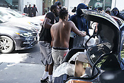 Men steal a safe from from Jamba Juice at 4th St. and Santa Monica Blvd. during a protest over the death of George Floyd, Sunday, May 31, 2020, in Santa Monica, Calif. Protests were held in U.S. cities over the death of Floyd, a black man who died after being restrained by Minneapolis police officers on May 25.