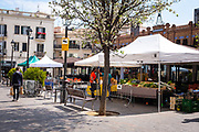 Mercat de Pagès, Sant Cugat del Valles, 28 March 2020. Open air fruit and vegetables for sale in Placa Sant Pere in Sant Cugat del Valles, outside Barcelona. Sant Cugat del Valles is a normally bustling city of some 90,000 people outside Barcelona. Two weeks after Spain put in place a state of Emergency to deal with the spread Coronavirus. Spain is one of the worst affected countries. Schools and retail businesses are closed, except for supermarkets and pharmacies.