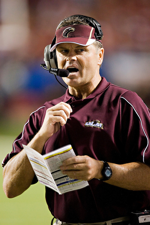 LITTLE ROCK, AR - SEPTEMBER 6:   Head Coach Charlie Weatherbie of the Louisiana-Monroe Warhawks signals in a play during a game against the Arkansas Razorbacks at War Memorial Stadium on September 6, 2008 in Little Rock, Arkansas.  The Razorbacks defeated the Warhawks 28-27.  (Photo by Wesley Hitt/Getty Images) *** Local Caption *** Charlie Weatherbie