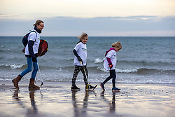 Pauline Allison with David and Anna Peebles. SSE Renewables doing the beach clean in Carnoustie on Saturday morning.