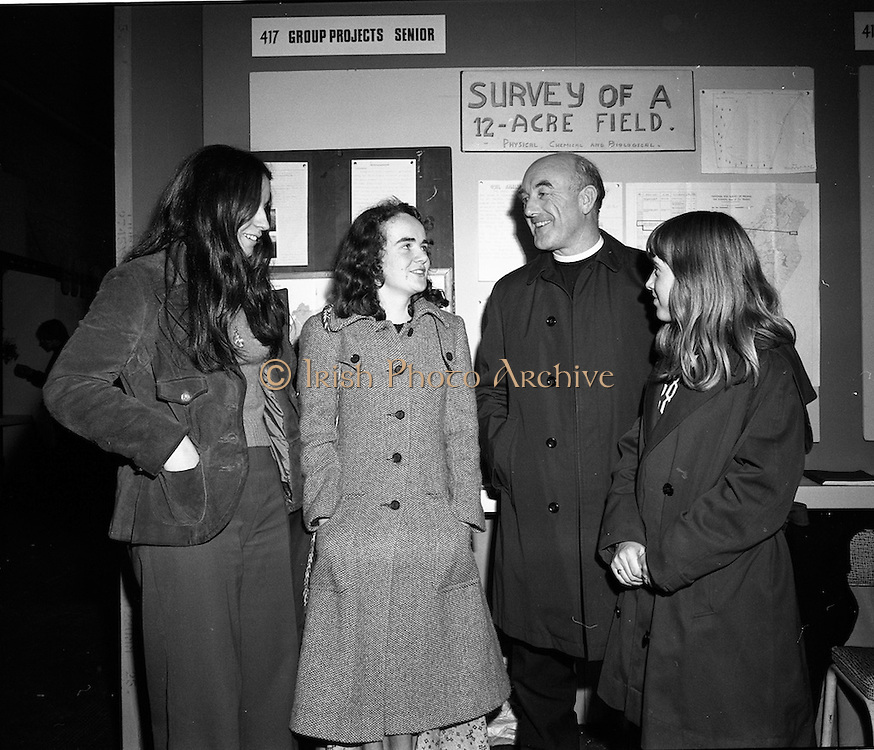 03/01/1975.01/03/1975.3rd January 1975.The Aer Lingus Young Scientist Exhibition at the RDS, Dublin...Picture shows L-R Aine Ni Shuilleabhain, Elizabeth Hurley, Fr. Christopher Cullen of CBS Gorey and Anna Gibney, all from Gorey.