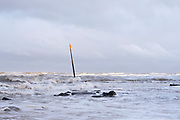 Golfbreker in zee bij het Zuiderstrand, Den Haag   Breakwater in the sea at the Zuiderstrand, The Hague
