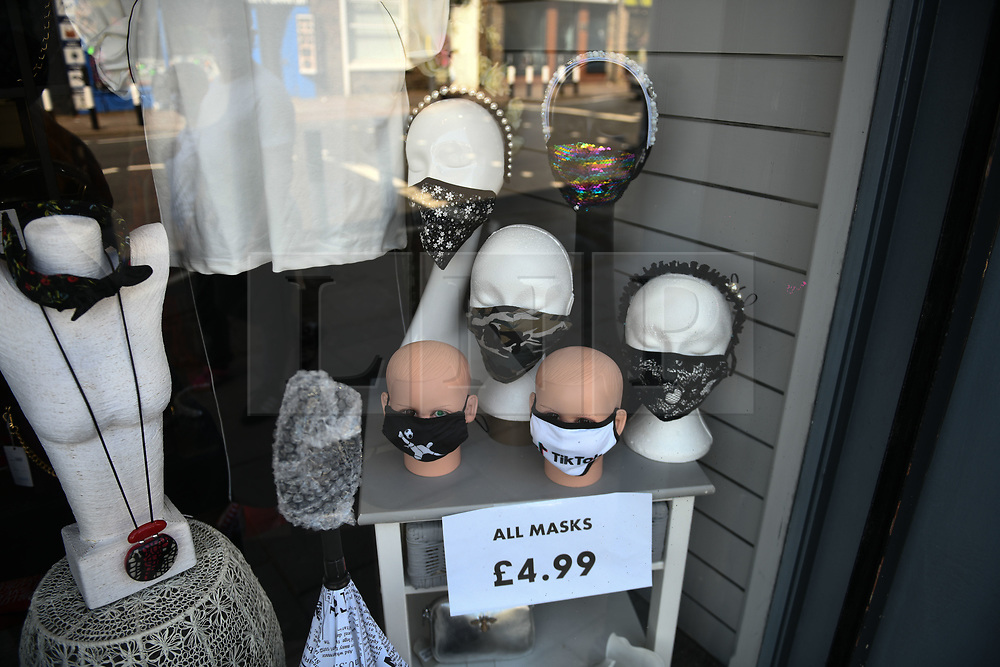 © Licensed to London News Pictures. 17/09/2020. Rhondda Valley, UK. Mask for asle in a shop window in the Rhondda Valley, which will go into local lockdown today after a spike in the coronavirus infection rate in the borough of Rhondda Cynon Taff in south Wales.. Photo credit: Robert Melen/LNP