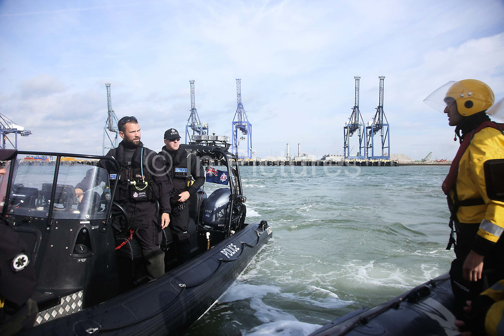 A Search and Marine police unit a at the scene in Sheerness harbour September 21st 2017, Thames Estuary, Kent, United Kingdom. Greenpeace volunteers in kayaks, speed boats and climbers on the jetty prevent the 23,498-tonne cargo ship Elbe Highway from docking at Sheerness in Kent.  The cargo ship is bringing Volkswagen diesel cars into the UK and the Greenpeace action is to prevent this from happening and to make VW ditch diesel. Two climbers board the ship and hang a banner on the roll-on roll-off part of the ship preventing any cars from being off-loaded. The action is part of a long running Greenpeace campaign to curb diesel emmissions and air pollution brought on by diesel cars.