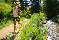 A young woman runs along a trail in the Cache Creek area near Jackson, Wyoming.