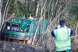 © Licensed to London News Pictures. 29/12/2015. Elland UK. A narrow boat has been left stranded on the banks of the Calder & Hebble Navigation at Park Nook Lock in Elland after recent flooding.  Photo credit: Andrew McCaren/LNP