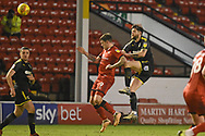 AFC Wimbledon midfielder Anthony Wordsworth (40) wins a header during the EFL Sky Bet League 1 match between Walsall and AFC Wimbledon at the Banks's Stadium, Walsall, England on 12 February 2019.