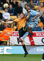 Photo: Steve Bond.<br />Wolverhampton Wanderers v Coventry City. Coca Cola Championship. 06/10/2007. Dele Adebola (R) wins the ball in the air.