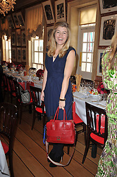 AMBER AIKENS at a lunch hosted by Roger Viver in honour of Bruno Frisoni their creative director, held at Harry's Bar, 26 South Audley Street, London on 31st March 2011.