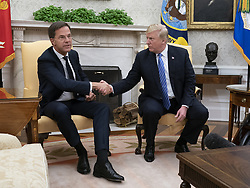 United States President Donald J. Trump meets with the Prime Minster of The Netherlands, Mark Rutte, at The White House in Washington, DC, July 2, 2018. Credit: Chris Kleponis / Abaca