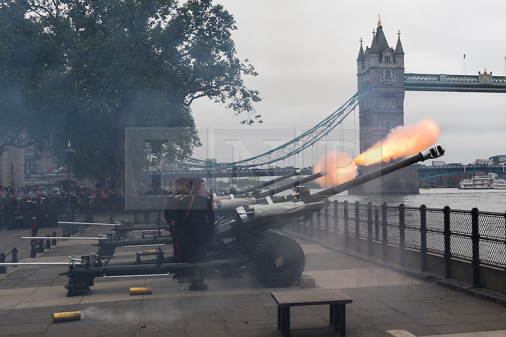 © Licensed to London News Pictures. 02/06/2016. LONDON, UK. Soldiers from the Honourable Artillery Company (HAC) fire a 62 round gun salute at The Tower of London, near Tower Bridge to mark the 63rd anniversary of the coronation of Great Britain's Queen Elizabeth II in 1953. A Royal Salute normally comprises 21 guns, but is increased to 41 if fired from a Royal Park or Residence and uniquely, at The Tower of London, a total of 62rounds are fired on Royal anniversaries, including an additional 21 guns for the citizens of the City of London to show loyalty to the Monarch.  Photo credit: Vickie Flores/LNP