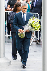City Hall, London, June 5th 2017.  Mayor of London Sadiq Khan prepares to lay flowers at a vigil held in remembrance of those killed during the June 3rd terror attack at London Bridge and Borough Market.