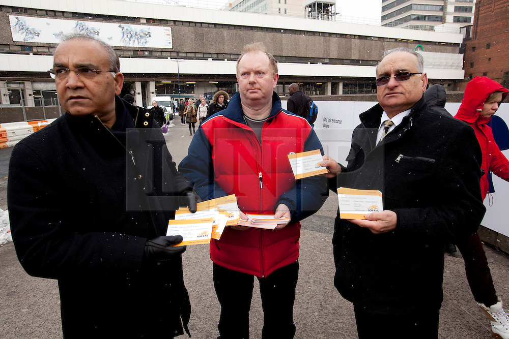 """© Licensed to London News Pictures. 27/3/2013. Birmingham, UK. Members of the RMT handing out """"Action for Rail"""" leaflets at New Street Station, Birmingham. Photo credit : Dave Warren/LNP"""