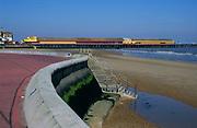 AF5GP0 Sea wall promenade, pier, and sandy beach Walton on Naze Essex England