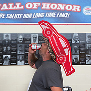 A fan finishes his beer before heading into the restroom at the Charlotte Motor Speedway before the start of the Sprint Cup Series Coca-Cola 600 on May 29th, 2016.