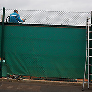 The umpire sits above the fence line on an outer court at Roland Garros during the French Open Tennis Tournament in Paris, France on Thursday, May 28, 2009. Photo Tim Clayton.