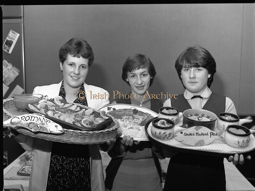 """""""The National Fish Cookery Award""""..29.04.1982..04.29.1982.29th April 1982.1982..This competition sponsored by Bord Iascaigh Mhara was held in The Clare Inn, Newmarket-on Fergus,Co Clare. the competition was open to schools across the country..The proud prize winners (L-R).Martha Browne (3rd),Catherine O'Sullivan (1st) and Miriam Henshaw (2nd) display their award winning dishes."""