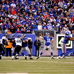 Quarterback Eli Manning #10 of the New York Giants passes the ball during NFL football action between the New York Giants and Jacksonville Jaguars on Nov. 28, 2010 at MetLife Stadium in East Rutherford, N.J.