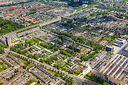 Nederland, Noord-Brabant, Eindhoven, 27-05-2013; stadsdeel Woensel-Noord, wijk Ontginning, buurt 't Hool.<br /> De woonbuurt met verschillende woningtypes is tussen 1968 en 1972 gerealiseerd en geldt als toonbeeld van de wederopbouw architectuur en stedenbouw. Architect Jaap Bakema.<br /> Residential area in Eindhoven with various housing types realized between 1968 and 1972. The design is considered a model of architecture and urban reconstruction. Architect Jaap Bakema.<br /> luchtfoto (toeslag op standard tarieven)<br /> aerial photo (additional fee required)<br /> copyright foto/photo Siebe Swart