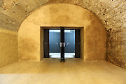 old cave in historic building, modern glass door