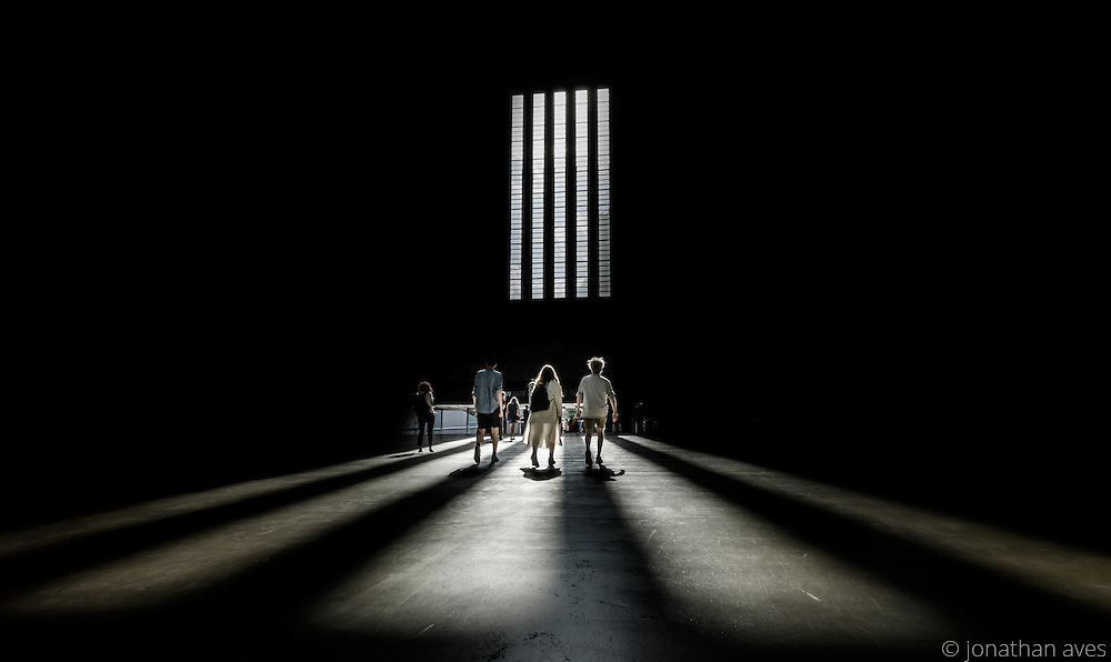 Visitors heading for the exit of the Turbine Hall in the Tate Modern Art Gallery, London, UK.
