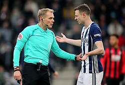 West Bromwich Albion's Jonny Evans (right) speaks with match referee Graham Scott (left) during the Premier League match at the Vitality Stadium, Bournemouth.