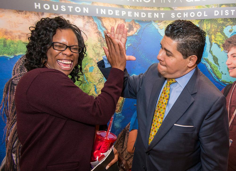 Houston ISD Superintendent Richard Carranza talks with recruits at a teacher job fair at the University of Houston, April 7, 2017.