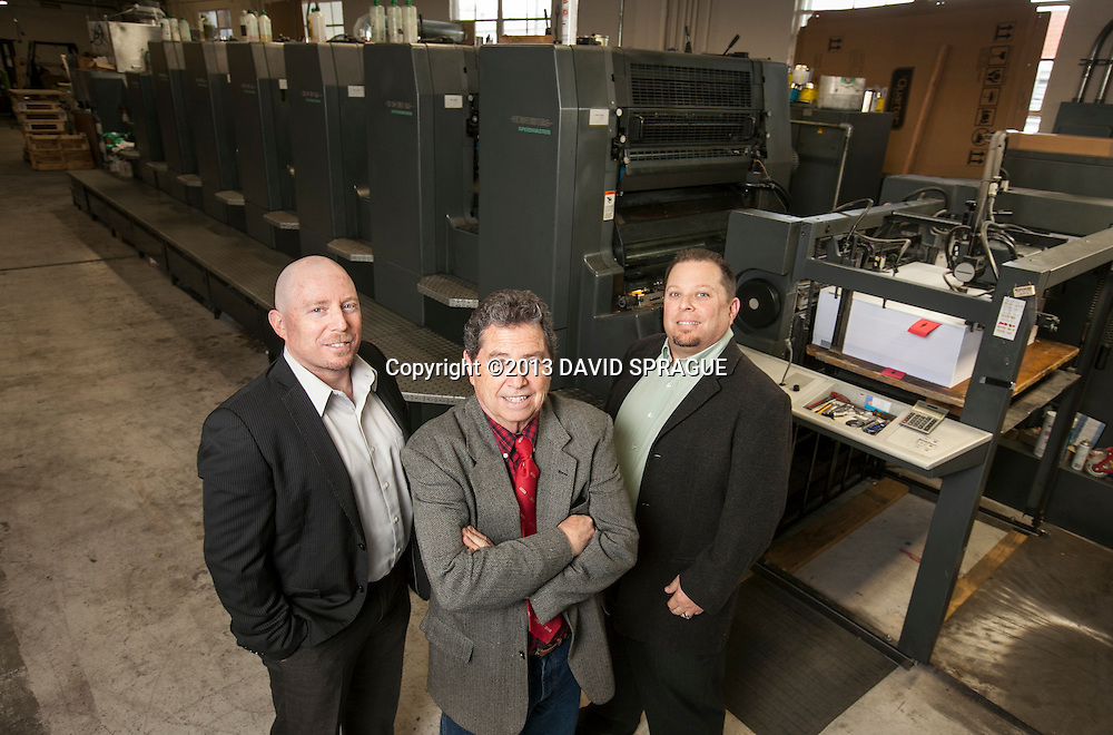 From left to right Phil, Jay and Fred Goldner, owners of The Harman Press, pose in front of their main press at the shop in North Hollywood, CA. Shot Feb. 19th,  2013 Photo by David Sprague ©2013
