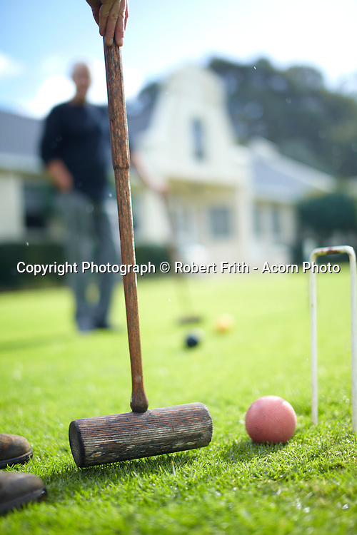 """Croquet on the lawn at Cape Lodge, Margaret River, Western Australia<br /> <br /> Voted Best Boutique Hotel in Australia 2009 & World's Best 100 Hotels 2010<br /> <br /> Sitting on its own secluded vineyard in the heart of the Margaret River Wine Country is one of Australia's finest boutique small luxury hotels.As you meander down the winding driveway of our intimate country estate you will discover why Cape Lodge was voted Luxury Travel Magazine's Best Boutique Hotel in Australia 2009 and listed as one of the """"World's Best 100 Hotels"""" 2010.<br /> <br /> Surrounded by stunning forest, lake and parkland scenery Cape Lodge is only minutes away from pristine beaches, coastline and the sparkling waters of the Indian Ocean and neighbours the great Margaret River wine estates of Mosswood, Vasse Felix, Cullen and Pier"""