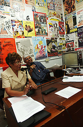 """Jose Ovalles,right, and Elida Polanco co-host the radion program """"Searching for America"""" on Radion Perola, a community radio station in western Caracas.  This episode of the show was mostly focused on pro-Chavez and anti-US rhetoric.  Chavez and his government have been increasingly supportive of these Chavista community media stations as a response to the anti-chavista private media."""