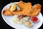 schnitzel, breaded fried meat cutlet of poultry breast with lemon and mashed potatoes