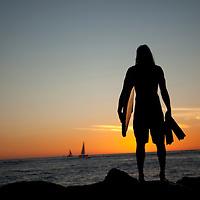 Unknown body boarder, silhouette on seawall, Ala Moana, Sunset