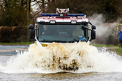 © Licensed to London News Pictures. 28/02/2020. East Cowick UK. A fire engine powers through flood water in East Cowick where residents have ben evacuated from their homes in Yorkshire as the UK prepares for storm Jorge. Photo credit: Andrew McCaren/LNP