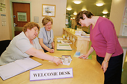 Volunteers man the Welcom Desk Reception at the entrance to the  Northern General Hospitals Huntsman Building