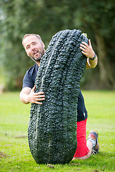 © Licensed to London News Pictures. 14/09/2018. Harrogate UK. Kevin Fortey with his heaviest Marrow that weighed 72.2kg at the Giant Vegetable Competition today at the Autumn Harrogate Flower Show in Harrogate. Photo credit: Andrew McCaren/LNP