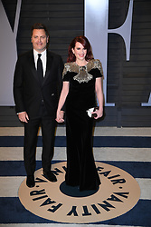 Nick Offerman (L) and Megan Mullally attending the 2018 Vanity Fair Oscar Party hosted by Radhika Jones at Wallis Annenberg Center for the Performing Arts on March 4, 2018 in Beverly Hills, Los angeles, CA, USA. Photo by DN Photography/ABACAPRESS.COM