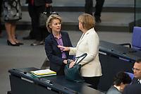 16 MAY 2013, BERLIN/GERMANY:<br /> Ursula von der Leyen (L), CDU, Bundesarbeitsministerin, und Angela Merkel (R), CDU, Bundeskanzlerin, im Gespraech, vor Beginn der Sitzung mit der Regirungserklaerung des Verteidigungsministers zur Neuausrichtung der Bundeswehr, Sitzung, Plenum, Deutscher Bundestag<br /> IMAGE: 20130516-01-014<br /> KEYWORDS: Gespräch
