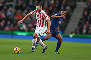Erik Pieters of Stoke city breaks away from Antonio Valencia of Man Utd.  Premier league match, Stoke City v Manchester Utd at the Bet365 Stadium in Stoke on Trent, Staffs on Saturday 21st January 2017.<br /> pic by Andrew Orchard, Andrew Orchard sports photography.