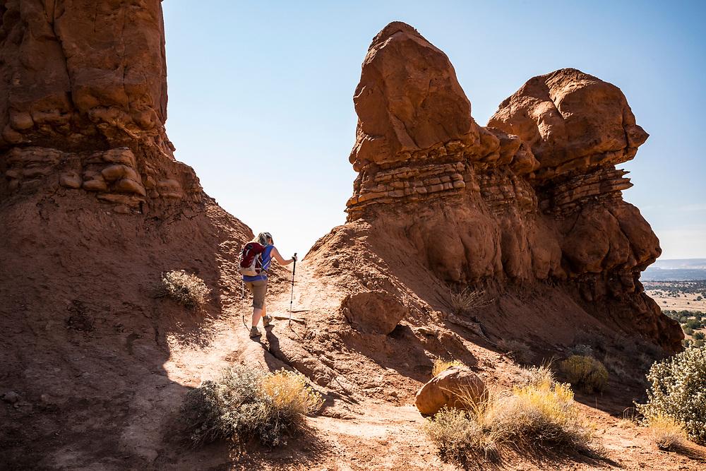 A woman hiking the Sentinel loop trail in Kodachrome Basin State Park Utah, USA.