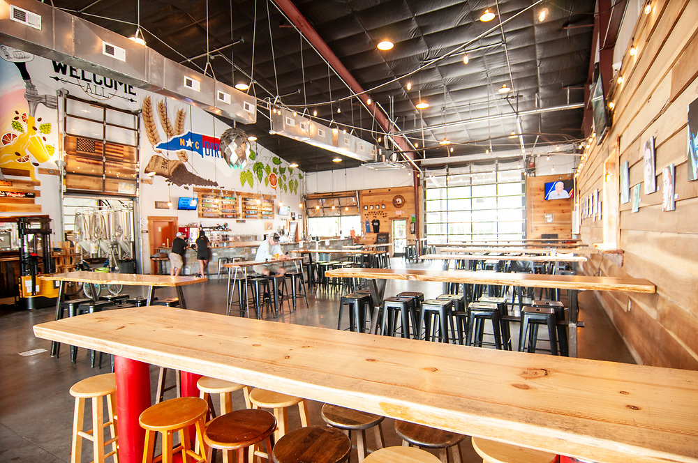 Indoor seating at the cavernous Dirtbag Ales Brewery & Taproom in Fayetteville, North Carolina on Tuesday, August 17, 2021. Copyright 2021 Jason Barnette