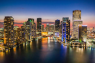 This aerial view of the mouth of the Miami River is framed by recently constructed condominium towers amongst the Downtown Miami skyline. Captured in 2010